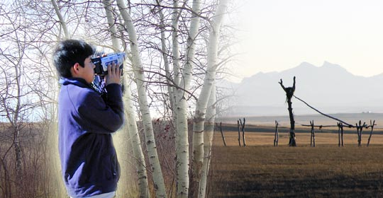 Bryce shooting video. Poplar poles support the cottonwood in the Sundance Lodge. (Photo courtesy of Narcisse Blood)