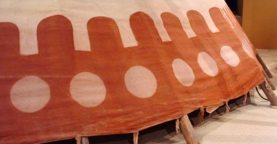 Puffballs painted on the canvas of a tipi. (Glenbow Museum. (2005). Nitsitapiisinni Exhibit. Calgary, Alberta: Blackfoot Gallery Committee.)