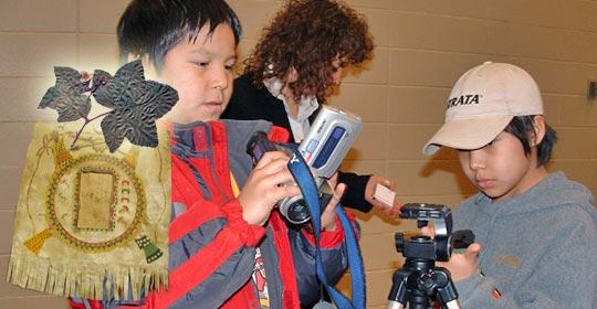 Japheth and Shelby both setting up the digital video equipement. (Glenbow Museum. (2005). Nitsitapiisinni Exhibit. Calgary, Alberta: Blackfoot Gallery Committee)